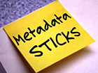 """metadata sticks"" written on a Post-it note"