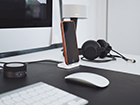 desk-with-computer-phone-and-headphones